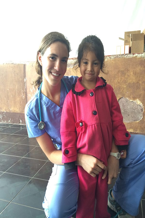 Kathryn+Getter+%28%2718%29+smiles+with+a+young+girl+she+treats.+%22I+was+the+one+who+had+seen+her+and+done+her+evaluation.+A+week+later+she+came+back+and+gave+me+a+hug+because+she+wasn%27t+sick+anymore+and+that+moment+made+m+life+worth+while.%22