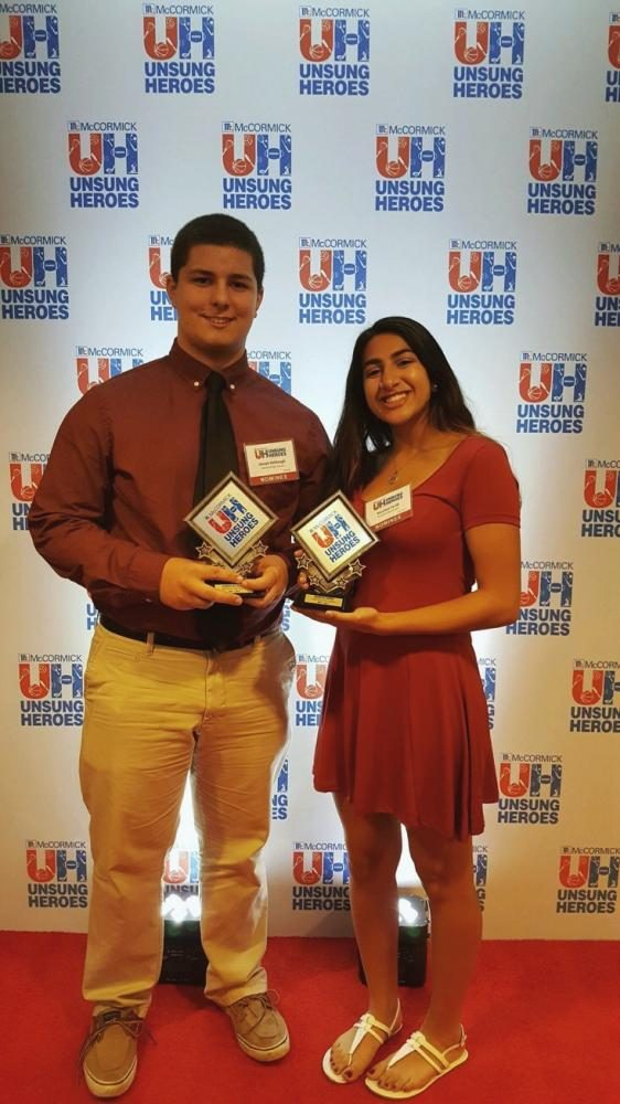 Kelbaugh+and+Faridi+hold+their+awards.+They+both+were+recognized+as+team+unsung+heroes.