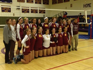 The Varsity volleyball team poses after winning the 2A regional finals. They beat Loch Raven   3-0  It feels awesome. said LeAnne Collins (12) We havent gone this far in a long time so it feels good to be a part of it.