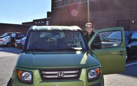 """Photo by Chad McCartin Posing with """"The Kiwi,"""" Christian Parsons (12) shows off his bright green Honda Element. Friends complimented the car for its """"space car"""" features, like a spacious interior, a huge front windshield, and a dashboard that changes colors."""