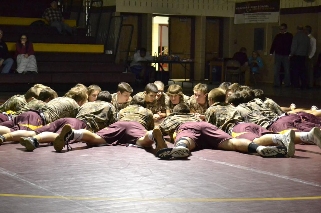"Photo by Chad McCartin The wrestling team practices after school. ""We didn't make it to the state tournament last year which was disappointing,"" said Mike Swiger (12)."