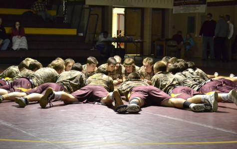"""Photo by Chad McCartin The wrestling team practices after school. """"We didn't make it to the state tournament last year which was disappointing,"""" said Mike Swiger (12)."""