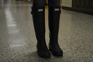 """Photo by William Wheatley  Hunter boots sell for anywhere from $125 to $795 dollars. Hunter boots were created to be worn out in the rain or on a farm. """"They are way over-priced for the way they look, and are a waste of money,"""" said Patrick Wetzelberger."""
