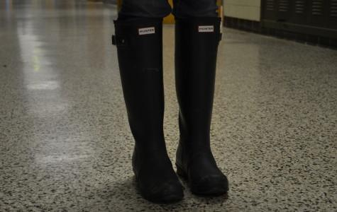 "Photo by William Wheatley  Hunter boots sell for anywhere from $125 to $795 dollars. Hunter boots were created to be worn out in the rain or on a farm. ""They are way over-priced for the way they look, and are a waste of money,"" said Patrick Wetzelberger."