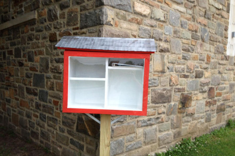 The Little Free Library stands near the auditorium doors. Nick Pindale('14) built this for the Hereford community.