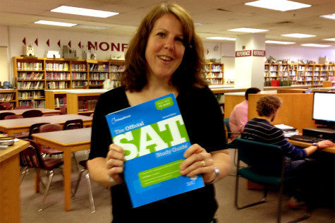 The Sat was administered on June 7 at schools all over the county. Kimberly Willard, the Sat Prep teacher, poses with this years Sat prep book.