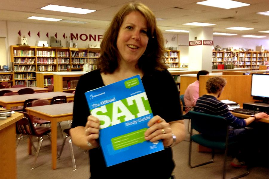 The+Sat+was+administered+on+June+7+at+schools+all+over+the+county.+Kimberly+Willard%2C+the+Sat+Prep+teacher%2C+poses+with+this+years+Sat+prep+book.