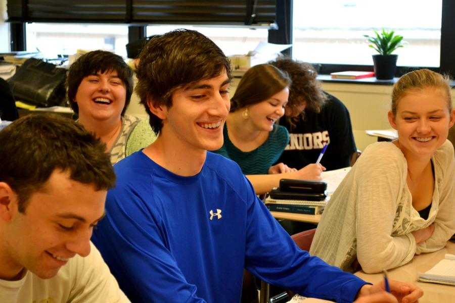 Steven Isett ('15) jokes with students during a Fishbowl Discussion in AP Literature and Composition class.  School-wide, teachers have been employing various discussion strategies in their courses.