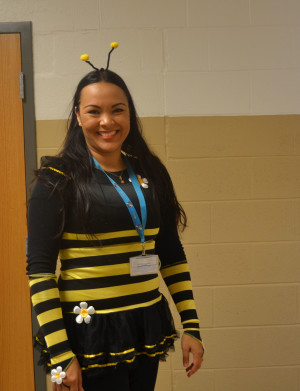 Spanish teacher, Angelica Anshel poses in her bumblebee costume.