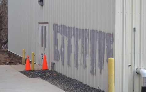 Gray paint covers the graffiti on the side of the weight room building. The cost to clean up the vandalism was about $5,000.
