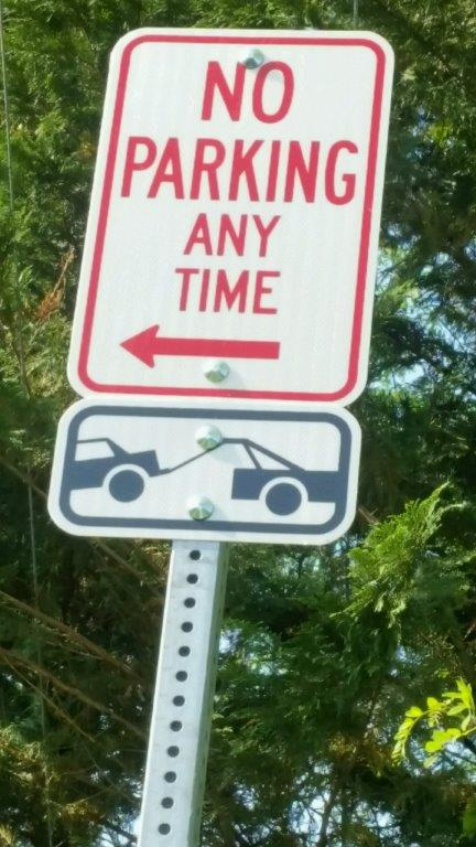 This sign indicates cars parked along Monkton Road will be towed.