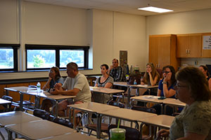 Parents visit their students classrooms and teachers at Back to School Night.