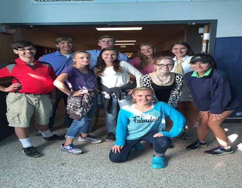 The journalism class poses for a picture.  They were dressed in generation day gear.
