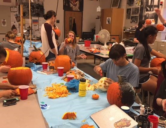 NAHS members gather to carve pumpkins for the 2016 Halloween season.