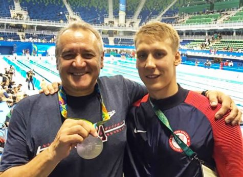 Athletic Director Mike Kalisz stands with his son Chase Kalisz at the Rio Olympics. Chase Kalisz took home a silver for the US in the 1400 meter Individual Medley.