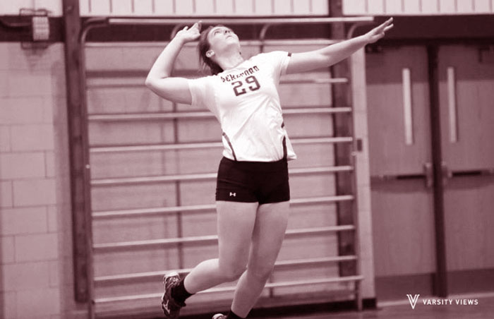 As+one+of+the+team%27s+top+servers+this+year%2C+Erin+Collins+jumps+into+the+air+to+give+a+solid+serve+over+the+net.