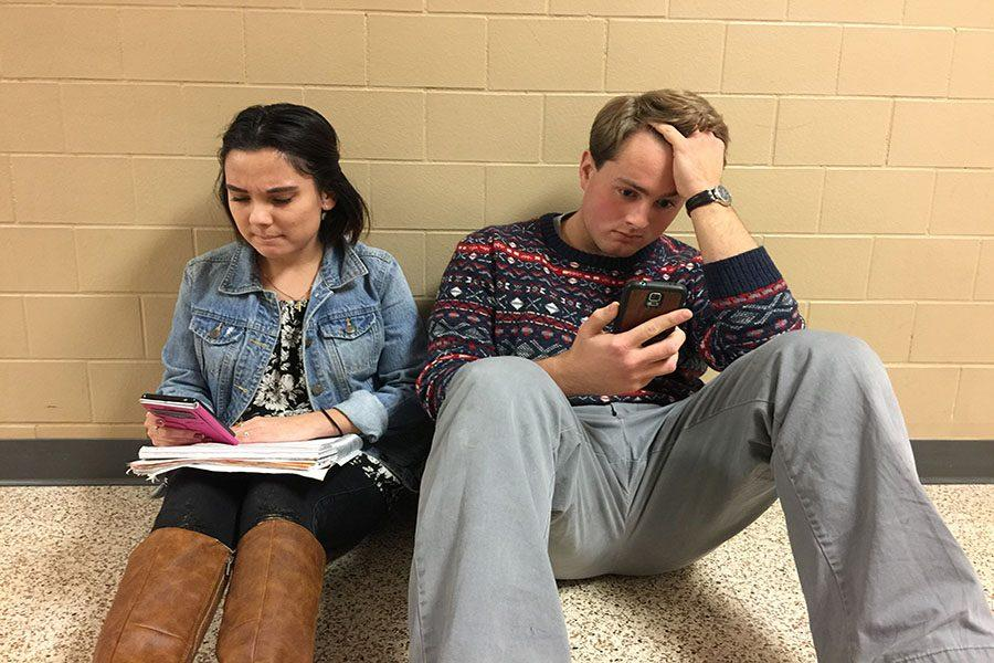 Students+are+distracted+by+their+phones+when+completeing+schoolwork.+Caitlynn+Hickey+%28%2717%29+and+Tony+Cabral+%28%2717%29+were+very+stressed+out.