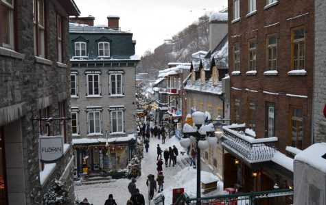 Natives and tourists visit shopping avenues during the snowy winter season in Quebec, where the French language is widely spoken.