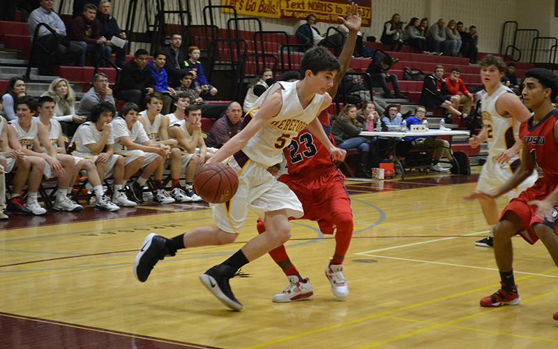 Point Guard Mason Greenspan ('19), drives baseline against a defender in the second half.