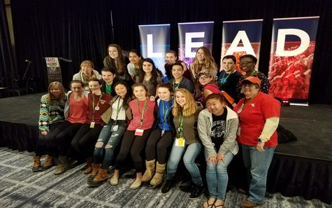 Leaders and advisors across Baltimore County sit on a stage at the National Association of Student Councils Leadership Conference. They attended the conference on Feb 3.