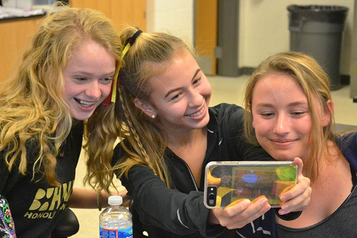 Abby+Walters+%28%2719%29%2C+Lily+Robertson+%28%2719%29%2C+and+Lynzie+Ritz+%28%2719%29+take+selfies+instead+of+studying+during+enrichment.+Robertson+sent+the+photo+to+friends+through+Snapchat.+
