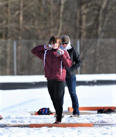 I set myself up to throw shot put, my coach Sarah Koehn looking on, during my first indoor track season as a junior. Looking back, I see that all the time I spend throwing shots into the snow is worth the pride that comes with being a Hereford athlete.