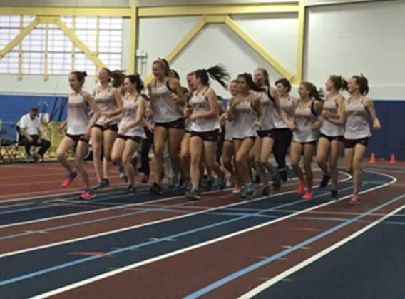 The girl's track team jog around the track. They became the 2A State Champions with a total of 89.5 points.