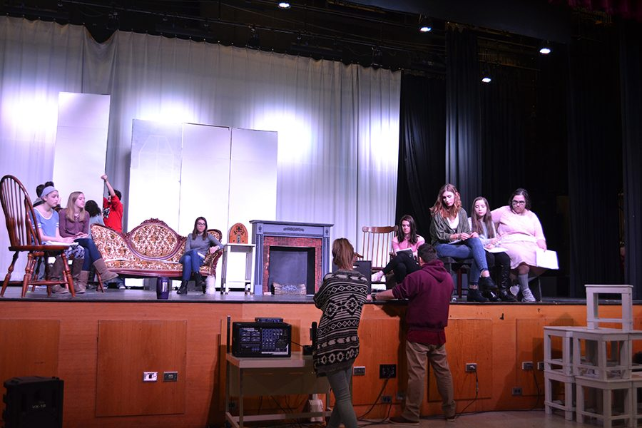 Actors listen to directions at rehearsal of