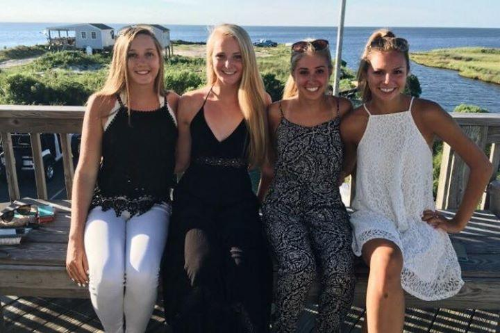 Diana Wittich ('17), Alex Butz ('17), Kaleigh Brown ('17), and I pose for a picture at a restaurant in the Outer Banks. We drove down and stayed for a full week in Avon.