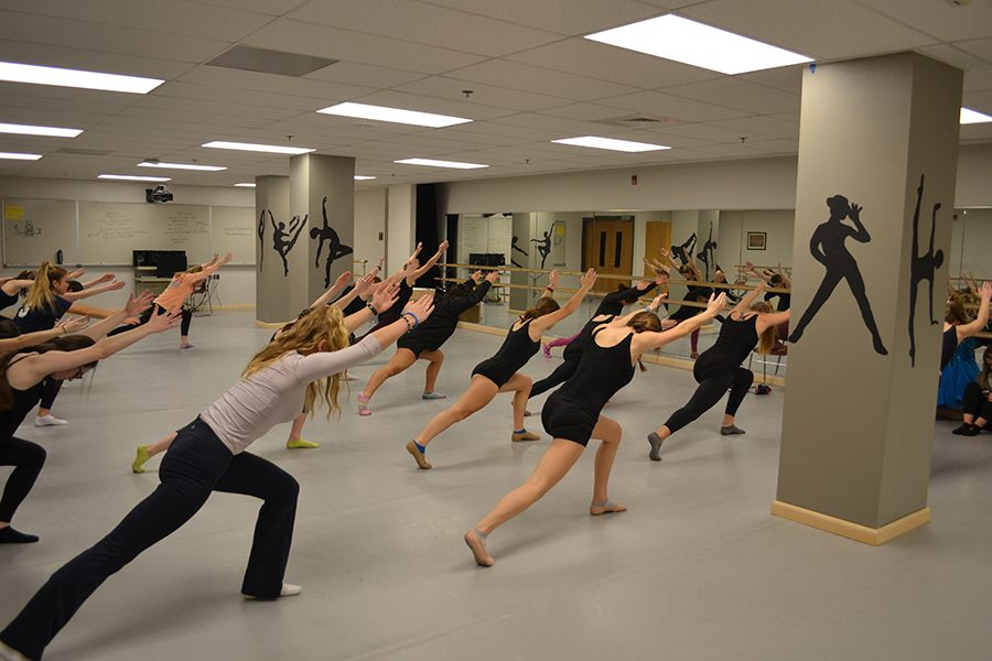Dance+4+prepares+for+rehearsal+with+their+modern+warm+up+sequence.