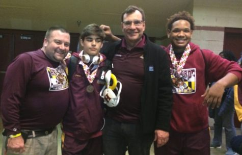 Wrestling Coach Brett Baier, Jimmy Cavin ('17), Coach Ron Causey, and Troy Gladney ('17) stand together for one last picture. Gladney and Cavin wrestled their last matches with the high school team at states on March 5.
