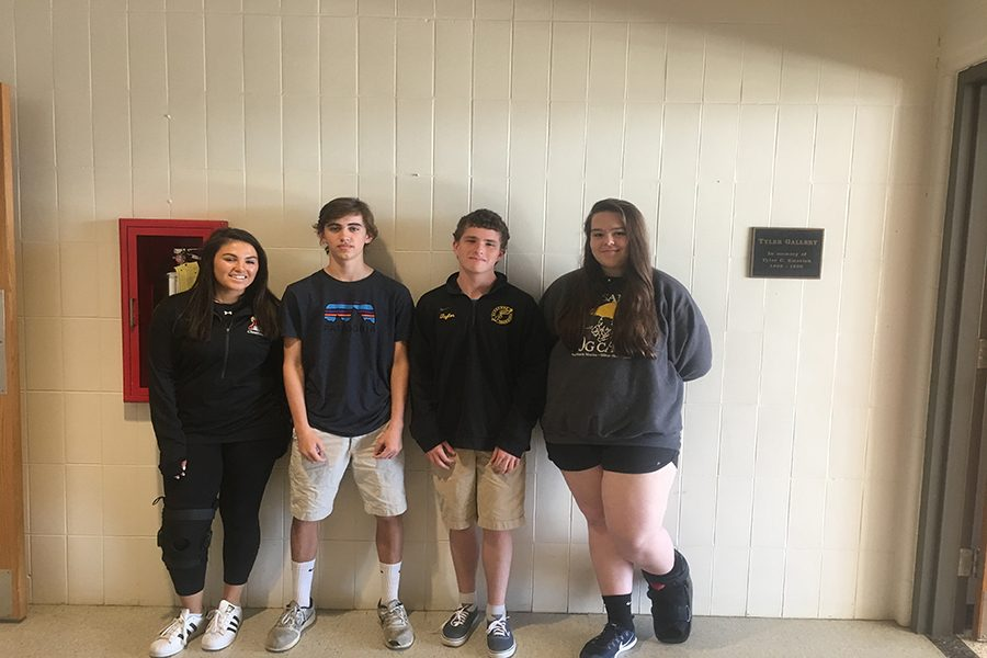 Lindsay Posner ('20), Ben Caputo ('20), Shane Taylor ('20), and Megan O'Donovan line up, knees in braces and ankles in boots. Their injuries have kept them off the playing field.