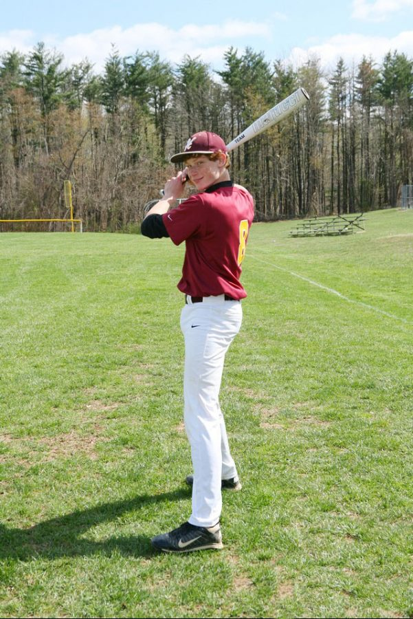 Marchineck stands ready to swing as a freshman on the Varsity baseball team.