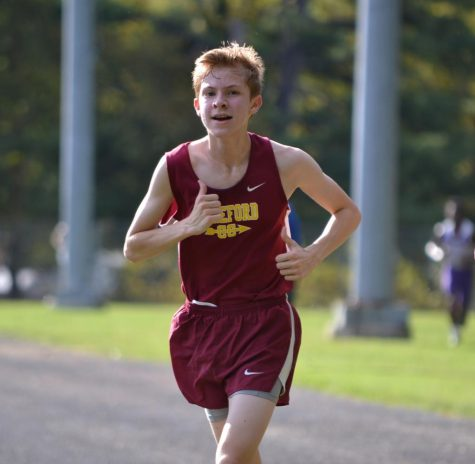 Jacob Robertson ('21) runs in the Winters Mill Cross Country Meet. Robertson set a personal record of 22 minutes and 24.9 seconds for the 5000 meter race.