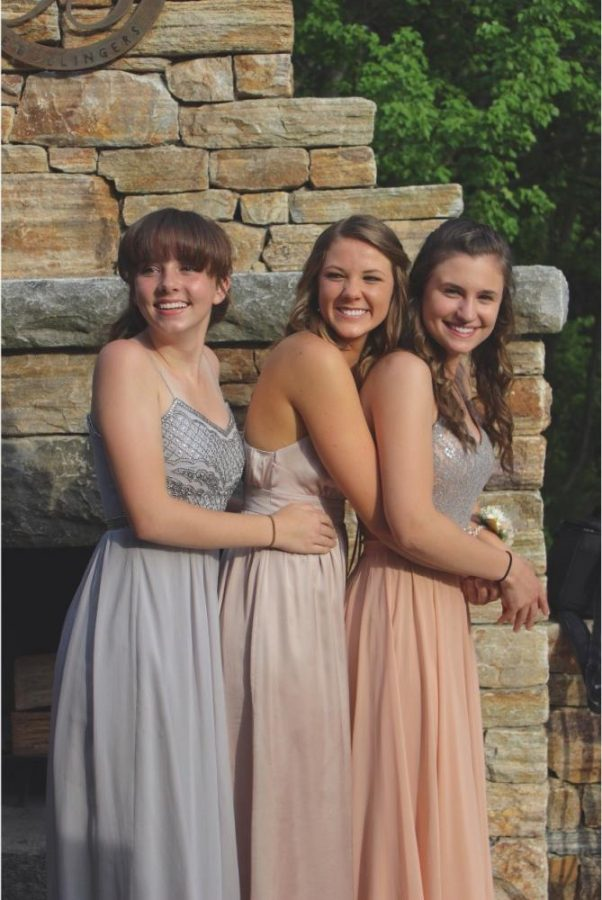 Nicole+Burkoski+joined+by+Abby+Daily+and+Jillian+Bollinger%2C+pose+for+pre-prom+pictures.+