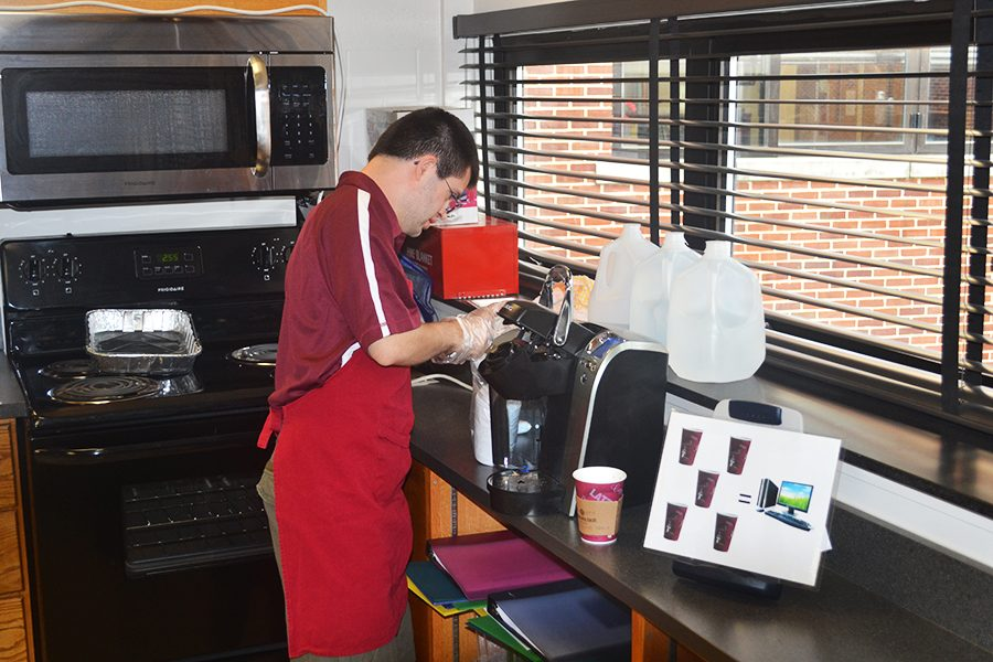 Tim Soots ('18) and his classmates make $1 coffee for teachers. Soots delivered the coffee to the teachers' rooms along with cream and sugar.