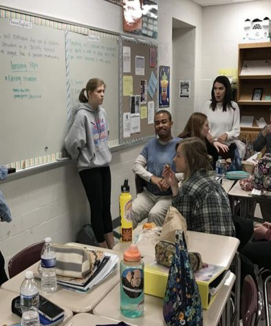Lila Carroll ('18) and fellow members of SADD club discuss upcoming January topic of eating disorders and record ideas of how to spread awareness about the issue during their weekly meeting on Dec. 20.