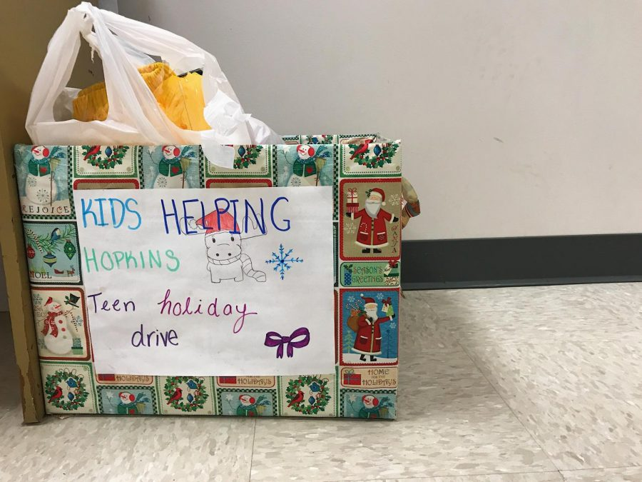 The collection box  is filled with toys and clothes . Kids Helping Hopkins held a drive to collect items to donate to patients at Johns Hopkins Children's Center.