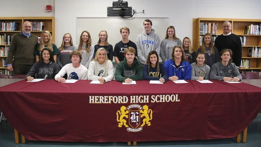 These+athletes+will+take+the+field+for+their+universities+in+their+freshmen+years%27.+Committed+DI%2C+DII%2Cand+DIII+athletes+of+the+Class+of+2018+gathered+in+the+Hereford+High+School+library+for+the+annual+Signing+Ceremony.+