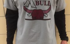 """Coach Walter flaunts his """"Fight Like a Bull"""" in support of the shootout. The shirts were designed by Daniel Stewart ("""