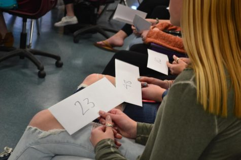 Members of Key Club receive their numbered envelopes which correspond to the minimum amount of money they must raise.