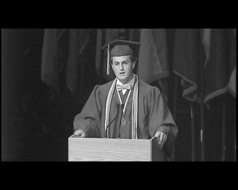 Tony Cabral ('17) addresses his class at graduation last year. Cabral hoped to inspire his class with a positive message of change in his speech he said.