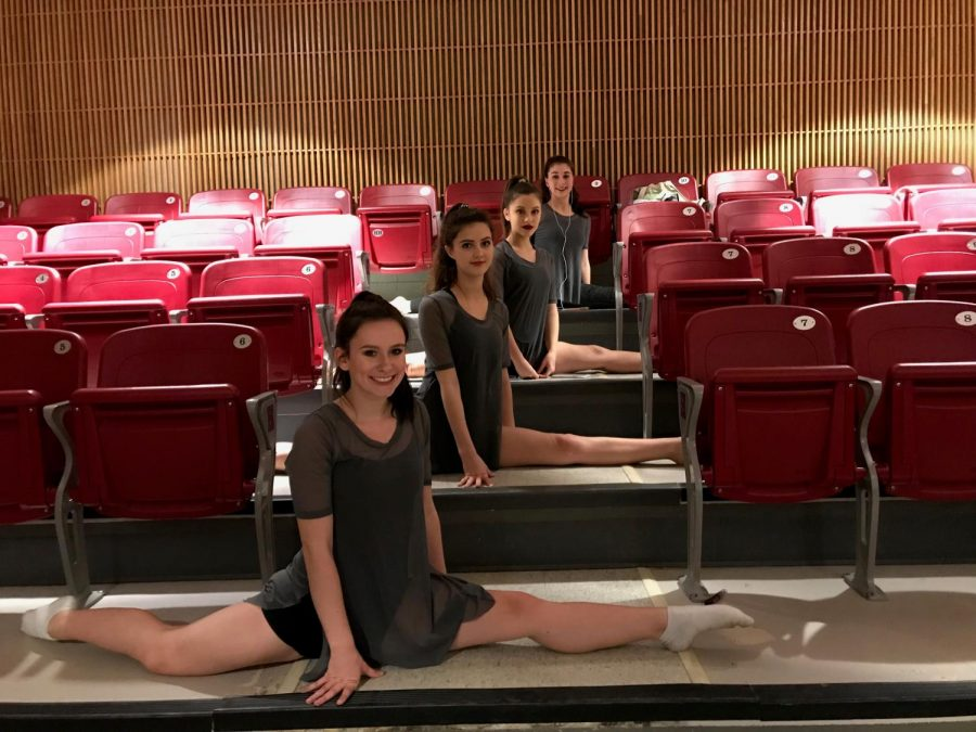 Smiling at the camera, the dance four dancers pose before their show. They  have rehearsed the past couple months for the spring show.