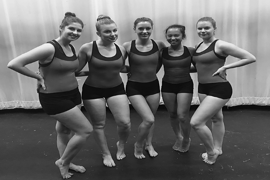 Megan Loomis ('18), Lily Albanese ('18), Gillian Tiralla ('18), Katrina Villanueva ('18), and Grace Isennock ('18) pose for a picture before their last winter performance. They will be performing on April 12 in their last ever high school performance.