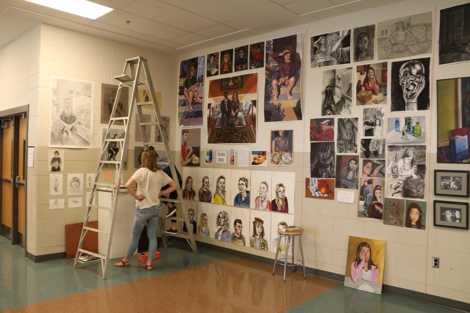 Hereford graduates set up their displays for the annual art show in the caffeteria. The AP Studio students showed off their portfolios to guests.