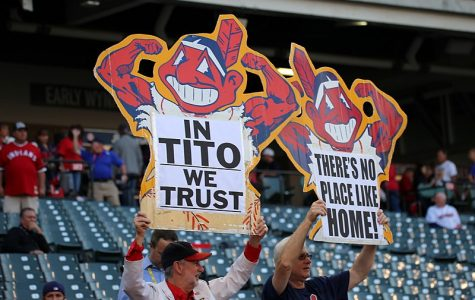 Diehard Cleveland Indians fans brandish their posters, sporting a muscular version of Chief Wahoo. The Indians made the decision, along with some encouragement from the MLB, to remove the logo after the 2018 season.
