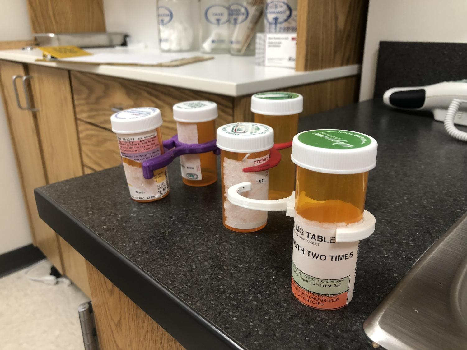 Nurse Perry uses pill bottle holders in her office. Engineering students made them to  solve the organization problem. some students have who take multiple prescriptions at school.