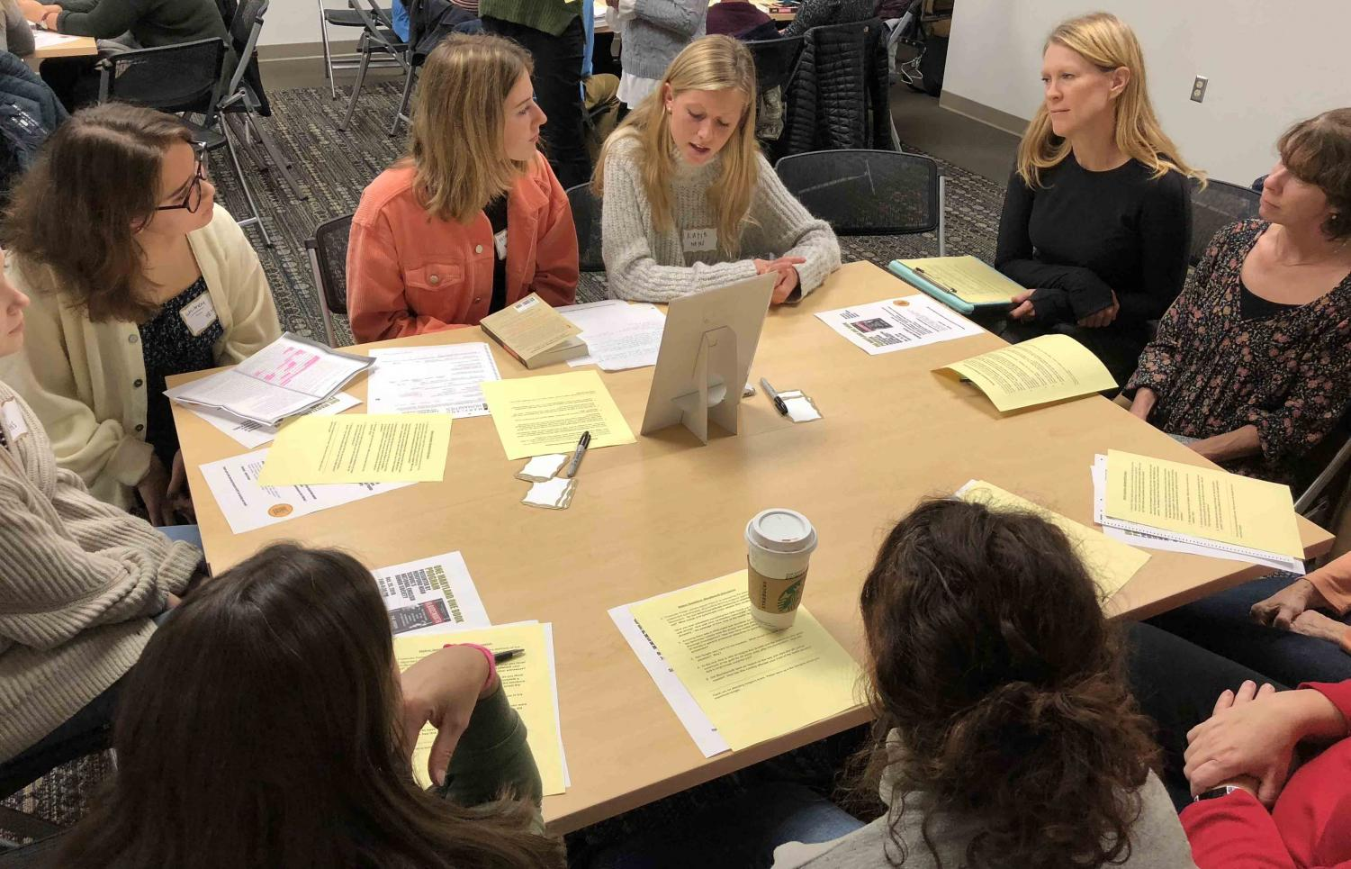 Victoria Westra ('20) asks questions to further the conversation about the book Bloodsworth. Members wrote questions before the book talk to be prepared to lead the group discussion.