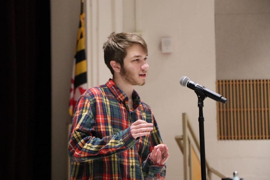 Garrick Rodman ('19) recites one of his poems for the school-wide competition. He performed in front of fellow competitors, judges and students that came to watch the contest.