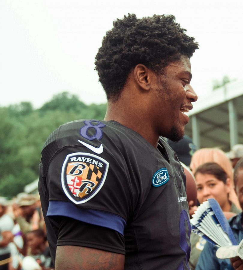 Lamar Jackson meets with fans after one of his first training camps. Jackson was the last pick of the first round of the 2018 NFL Draft.